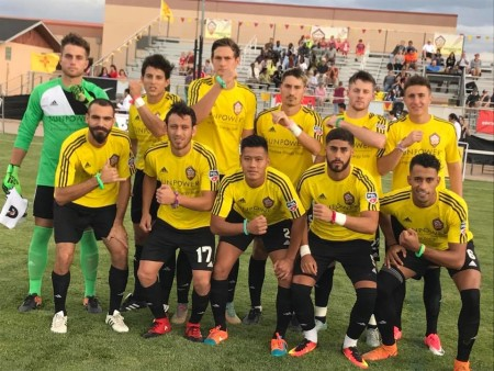 The Sol pose for their traditional team picture on 7/13 wearing wristbands made for them by a UNM Children's Hospital Patient whom the team visited earlier in the week.